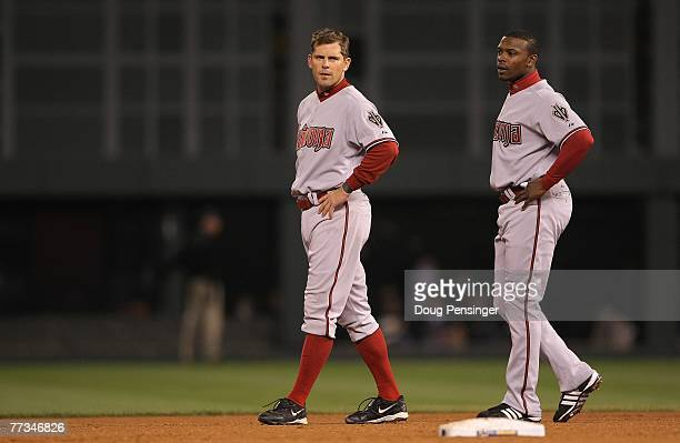 Jeff Cirillo and Justin Upton of the Arizona Diamondbacks look on after Cirillo grounded out to end the top of the second inning against the Colorado...