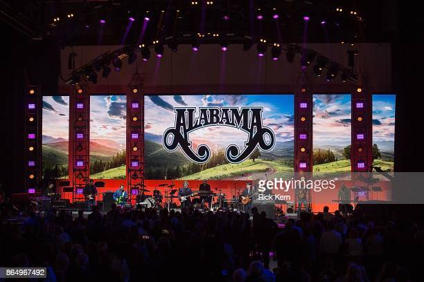 Jeff Cook Randy Owen and Teddy Gentry of Alabama perform onstage during the 'Deep from the Heart The One America Appeal Concert' at Reed Arena on the...