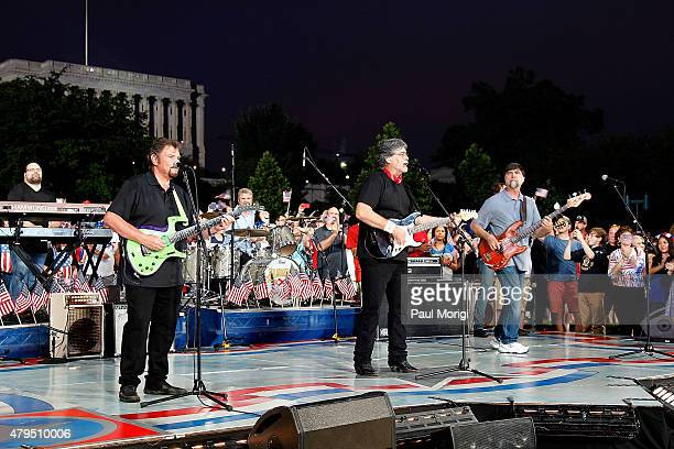 Jeff Cook Randy Owen and Teddy Gentry of the country music band Alabama perform at A Capitol Fourth 2015 Independence Day concert at the US Capitol...