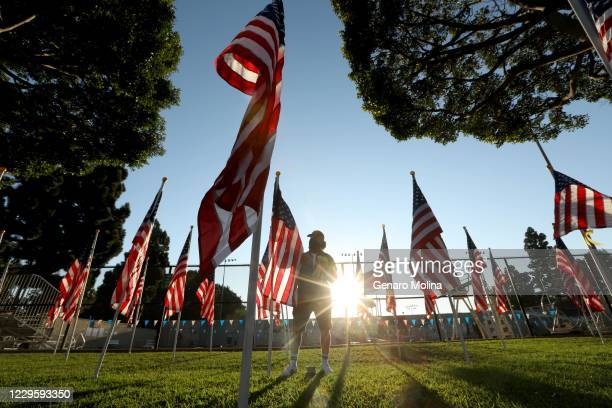 CITY CA NOVEMBER 11 2020 Jeff Cooper president of Culver City Exchange places ribbons on each flag with the name of a vet for the display called...