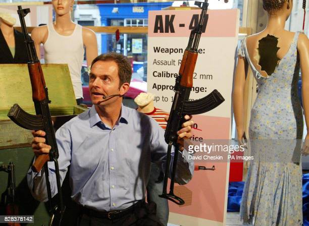 Jeff Cotton sells AK47 machine guns in a spoof shop on Edinburgh`s High street created as part of a campaign by Amnesty International Oxfam and the...