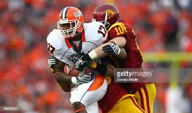 """Jeff Cumberland of the Illinois Fighting Illini runs against the defense of Brian Cushing of the USC Trojans during the """"Rose Bowl presented by Citi""""..."""
