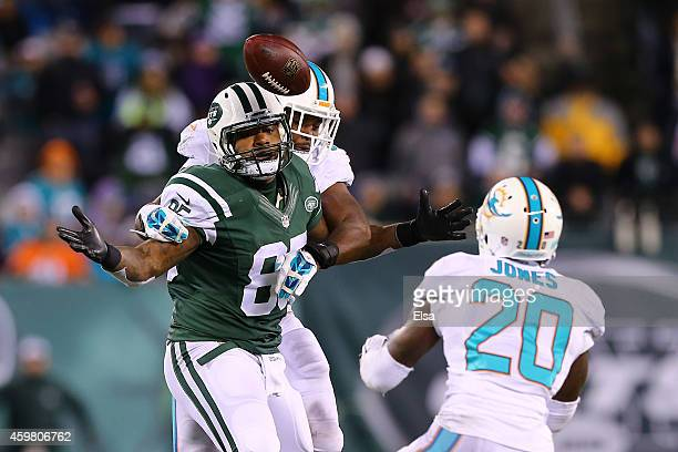 Jeff Cumberland of the New York Jets misses a pass thats intercepted by Reshad Jones of the Miami Dolphins late in the fourth quarter during their...