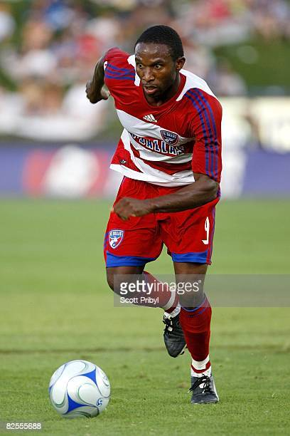 Jeff Cunningham of FC Dallas dribbles the ball against the Kansas City Wizards during the game at Community America Ballpark on August 23, 2008 in...