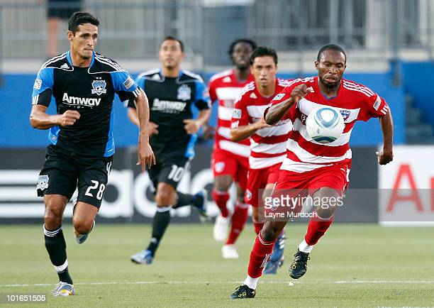 Jeff Cunningham of FC Dallas runs to the ball against Andre Luiz of the San Jose Earthquake at Pizza Hut Park on June 5 2010 in Frisco Texas