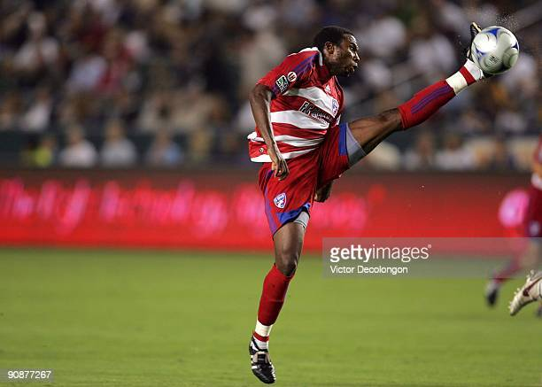 Jeff Cunningham of FC Dallas stretches his left leg to play down a crossing pass to the goal box in the first half against the Los Angeles Galaxy...