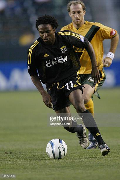 Jeff Cunningham of the Columbus Crew plays the ball past Simon Elliott of the Los Angeles Galaxy during their Major League Soccer game against the...