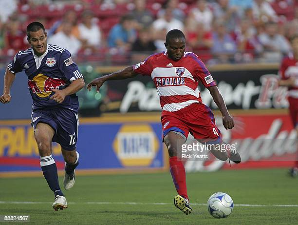 Jeff Cunningham of the FC Dallas shoots the ball while Mike Petke of the New York Red Bulls tries to catch up at Pizza Hut Park on July 4, 2009 in...