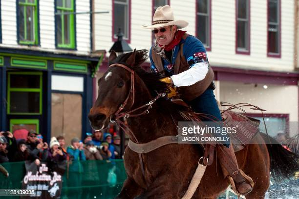 Jeff Dahl races down Harrison Avenue during the 71st annual Leadville Ski Joring weekend competition on March 2 2019 in Leadville Colorado Skijoring...