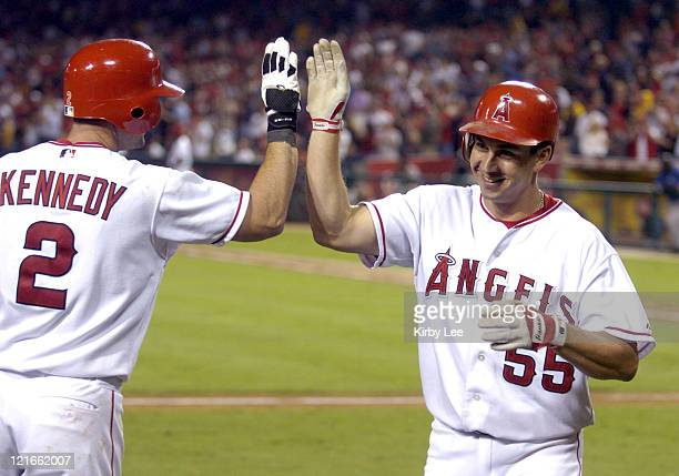 Jeff DaVanon of the Anaheim Angels is congratulated by Adam Kennedy after a solo home run in the seventh inning of 216 victory over the Kansas City...