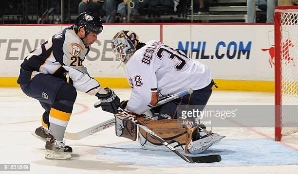Jeff Deslauriers of the Edmonton Oilers blocks a breakaway shot against Steve Sullivan of the Nashville Predators on October 12 2009 at the Sommet...