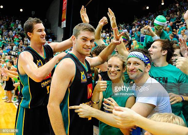 Jeff Dowdell and Keegan Tudehope acknowledge the crowd after winning game two of the NBL semi final series between the Townsville Crocodiles and the...