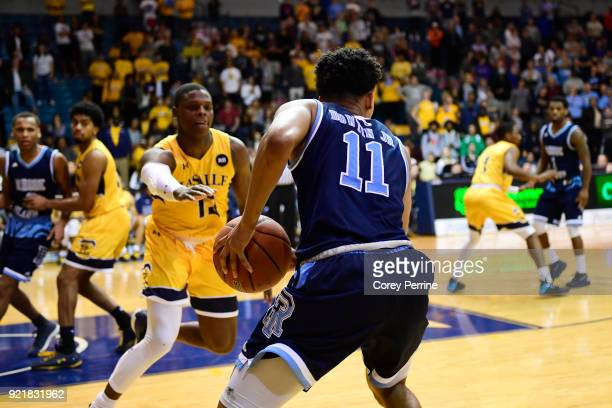 Jeff Dowtin of the Rhode Island Rams holds on to the ball for the win as the La Salle Explorers can't make a final foul in time during overtime at...