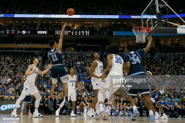 Jeff Dowtin of the Rhode Island Rams shoots the ball against the Duke Blue Devils during the first half in the second round of the 2018 NCAA Men's...