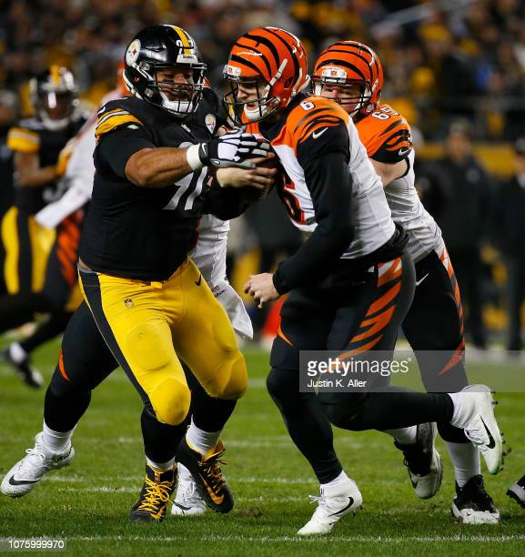 Jeff Driskel of the Cincinnati Bengals is pressured by Cameron Heyward of the Pittsburgh Steelers in the third quarter during the game at Heinz Field...