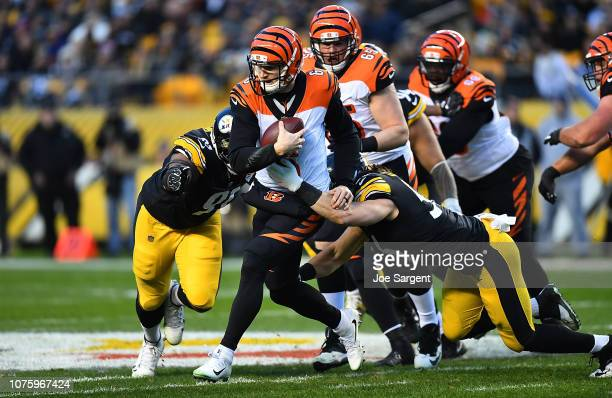 Jeff Driskel of the Cincinnati Bengals is wrapped up for a sack by Anthony Chickillo of the Pittsburgh Steelers in the first quarter during the game...