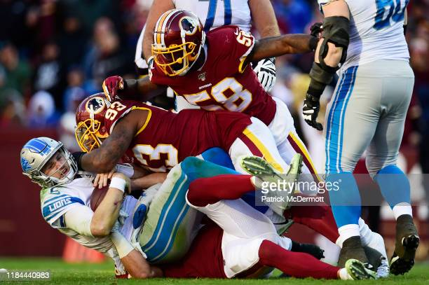 Jeff Driskel of the Detroit Lions is sacked by Jonathan Allen and Ryan Kerrigan of the Washington Redskins in the second quarter at FedExField on...