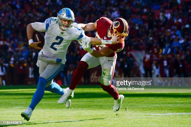 Jeff Driskel of the Detroit Lions stiffarms Cole Holcomb of the Washington Redskins in the first half at FedExField on November 24 2019 in Landover...