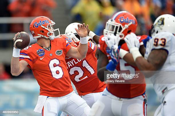 Jeff Driskel of the Florida Gators drops back to pass against the East Carolina Pirates during the second quarter of the Birmingham Bowl at Legion...
