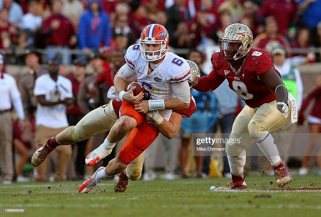 Jeff Driskel #6 of the Florida Gators is sacked during a game against the Florida State Seminoles at Doak Campbell Stadium on November 24, 2012 in Tallahassee, Florida.