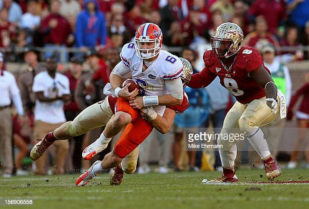 Jeff Driskel of the Florida Gators is sacked during a game against the Florida State Seminoles at Doak Campbell Stadium on November 24 2012 in...