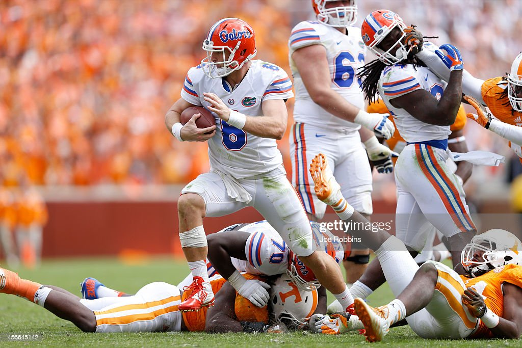 Jeff Driskel #6 of the Florida Gators tries to escape pressure during game against the Tennessee Volunteers at Neyland Stadium on October 4, 2014 in Knoxville, Tennessee. Florida defeated Tennessee 10-9.