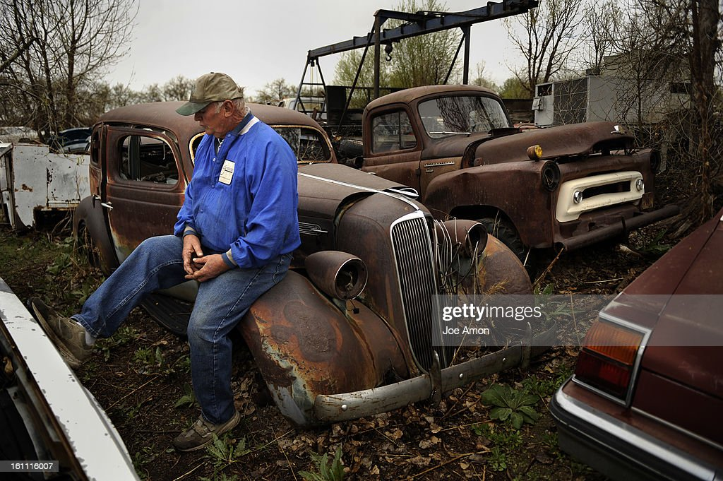 Jeff Elms setting on the first car he ever bought, a 1936 Studebaker ...
