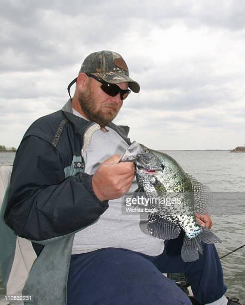 Jeff Ensz fishes for crappie on Glen Elder Lake in Kansas in April 2010
