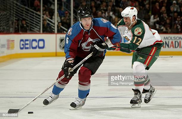 Jeff Finger of the Colorado Avalanche controls the puck as Brian Rolston of the Minnesota Wild defends at the Pepsi Center on April 6 2008 in Denver...