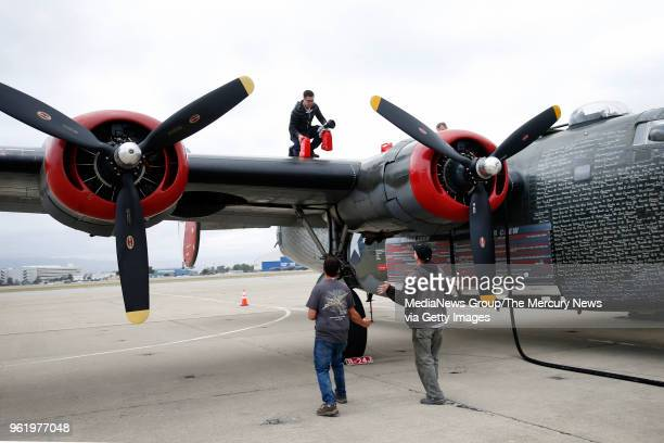 Jeff Fink adds 120W oil to the Consolidated B24 Liberator Witchcraft part of the Wings of Freedom Tour visiting Moffett Field in Mountain View Calif...