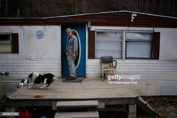 Jeff Fletcher opens the door to his mobile home on Thursday November 21 2013 in Jackson Ky Fletcher an uninsured resident of Breathitt County was...