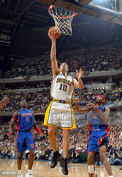 Jeff Foster of the Indiana Pacers gets a wide open layup against Richard Hamilton and Ben Wallace of the Detroit Pistons in Game three of the Eastern...