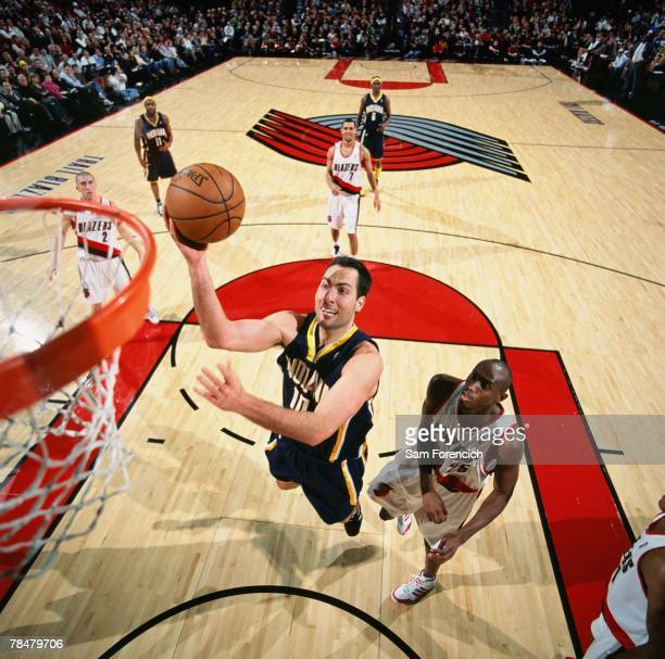 Jeff Foster of the Indiana Pacers goes up for a shot against Travis Outlaw of the Portland Trail Blazers during the game at the Rose Garden Arena on...