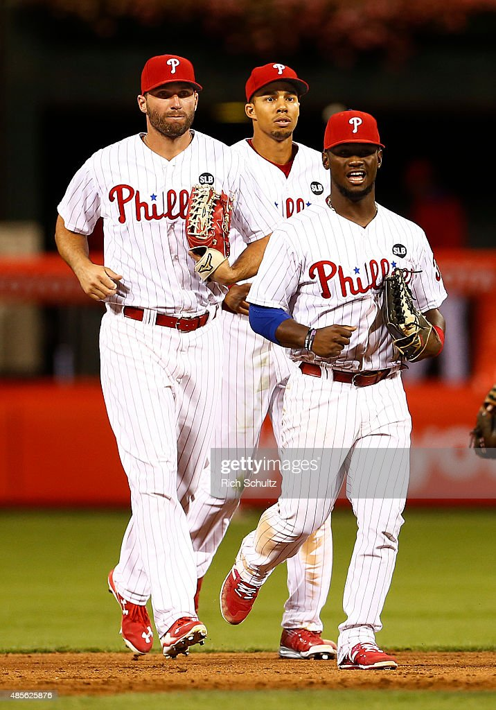 Jeff Francoeur #3, Aaron Altherr #40 Odubel Herrera #37, left to right, of the Philadelphia Phillies after the Phillies defeated the San Diego Padres 7-1in a MLB game at Citizens Bank Park on August 28, 2015 in Philadelphia, Pennsylvania.