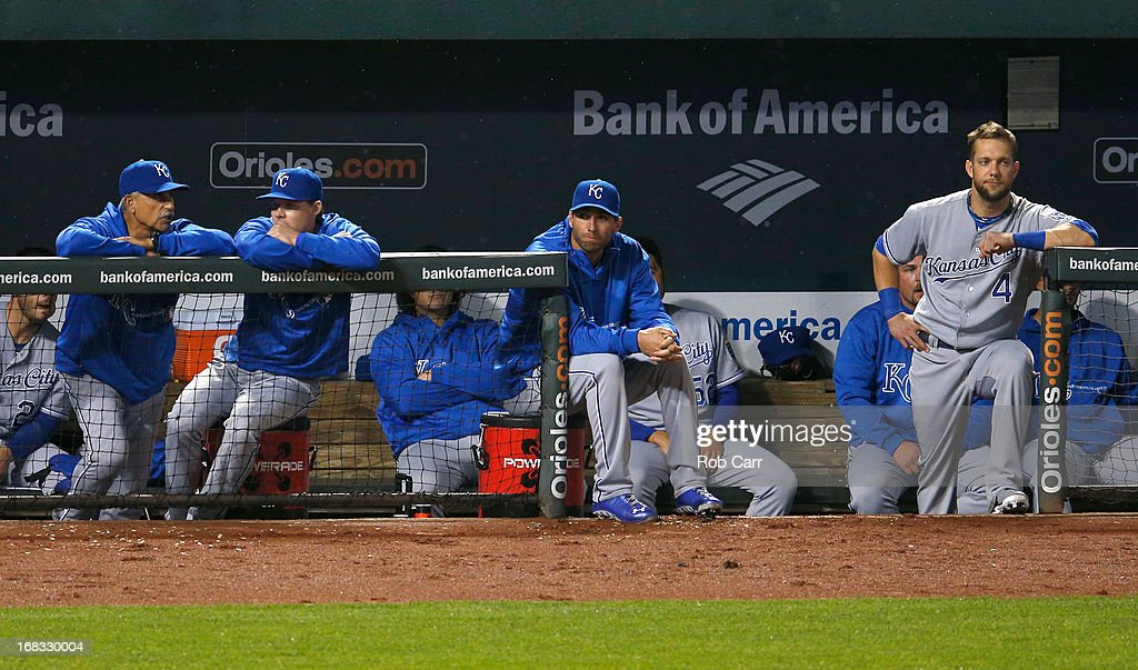 Jeff Francoeur #21 (C), Alex Gordon #4 (R) and other members of the Kansas City Royals look on from the dugout during the eighth inning of the Royals 5-3 loss to the Baltimore Orioles at Oriole Park at Camden Yards on May 8, 2013 in Baltimore, Maryland.