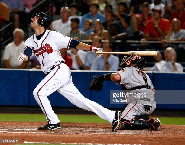 Jeff Francoeur of the Atlanta Braves hits a pop fly while San Francisco Giants catcher Bengie Molina looks on during the game on August 14 2007 at...