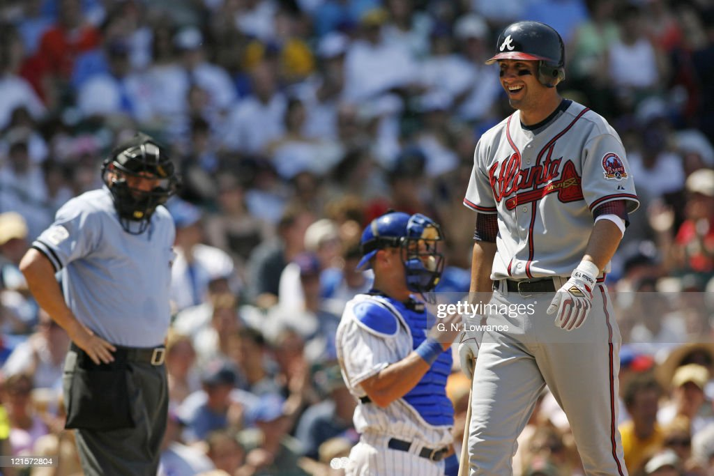 Jeff Francoeur of the Braves smiles sarcastically after getting called out looking on strike 3 by umpire Jerry Crawford during action between the Atlanta Braves and Chicago Cubs at Wrigley Field in Chicago, Illinois on May 28, 2006. The Braves won 13-12 in 11 innings.