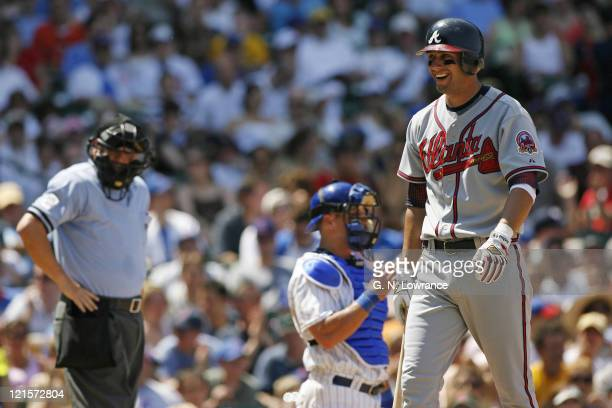 Jeff Francoeur of the Braves smiles sarcastically after getting called out looking on strike 3 by umpire Jerry Crawford during action between the...