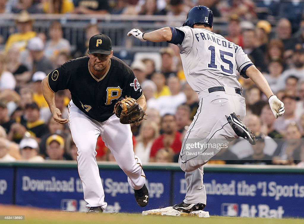 Jeff Francoeur #15 of the San Diego Padres is out at first as Gaby Sanchez #17 of the Pittsburgh Pirates makes the play during the fifth inning of their game on August 9, 2014 at PNC Park in Pittsburgh, Pennsylvania. The Padres defeated the Pirates 2-1.