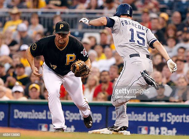 Jeff Francoeur of the San Diego Padres is out at first as Gaby Sanchez of the Pittsburgh Pirates makes the play during the fifth inning of their game...