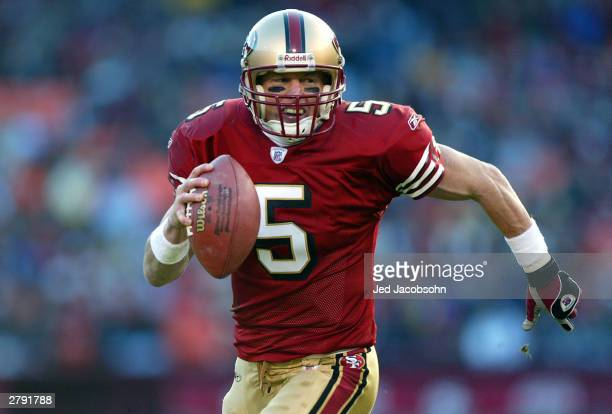 Jeff Garcia of the San Francisco 49ers runs for a touchdown against the Arizona Cardinals during an NFL game on December 7 2003 at Candelstick Park...