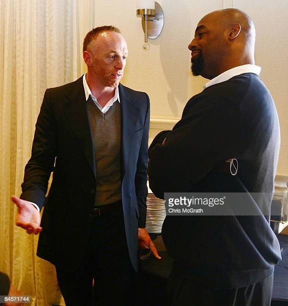 Jeff Garcia talks with Donovan McNabb at the launch of the Isaac Daniel, ID Coach at the Sheraton Riverwalk on January 31, 2009 in Tampa, Florida....