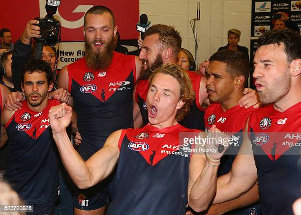Jeff Garlett Max Gawn Lynden Dunn Jayden Hunt Neville Jetta and Cameron Pedersen of the Demons sing the song in the rooms after winning the round...