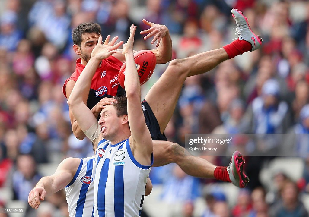 Jeff Garlett of the Demons attempts to mark over the top of Sam Wright of the Kangaroos during the round 19 AFL match between the Melbourne Demons and the North Melbourne Kangaroos at Melbourne Cricket Ground on August 9, 2015 in Melbourne, Australia.