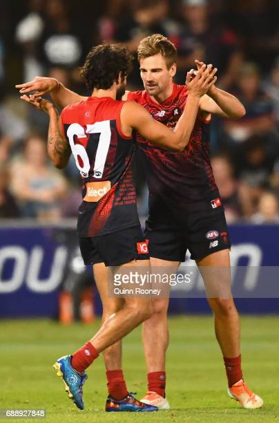 Jeff Garlett of the Demons is congratulated by Dom Tyson after kicking a goal during the round ten AFL match between the Melbourne Demons and the...