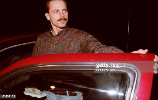 Jeff Gillooly exhusband of figure skater Tonya Harding listens to questions from cameramen 15 January 1994 after picking up the mail outside the...