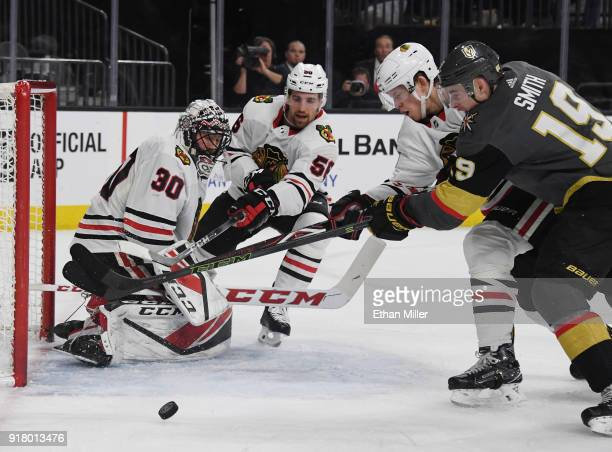 Jeff Glass of the Chicago Blackhawks blocks a shot by Reilly Smith of the Vegas Golden Knights as Erik Gustafsson and Connor Murphy of the Blackhawks...