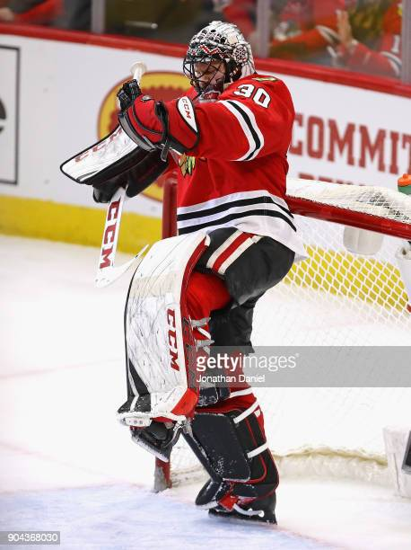 Jeff Glass of the Chicago Blackhawks celebrates his first home win against the Winnipeg Jets at the United Center on January 12 2018 in Chicago...