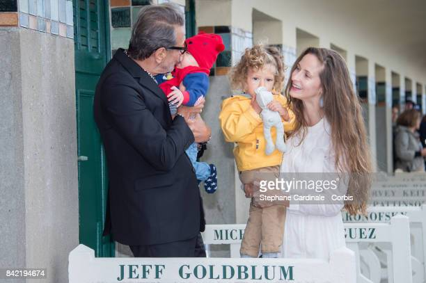 Jeff Goldblum his sons River Joe and Charlie Ocean and his wife Emilie Livingston pose in front of Goldblum's dedicated beach locker room on the...