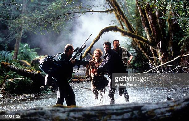 Jeff Goldblum Julianne Moore and Vince Vaughn running through water trying to escape danger in a scene from the film 'The Lost World Jurassic Park'...